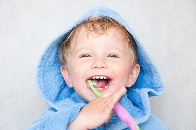 young boy brushing teeth before dental visit l pediatric dentistry wylie