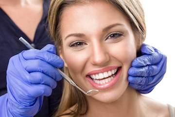 woman smiling after dental exam l cosmetic dentistry wylie tx