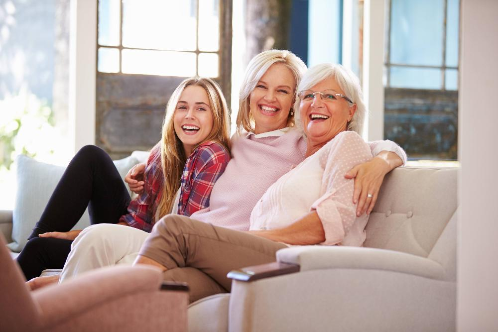 three generations of women smiling on couch l dentist wylie