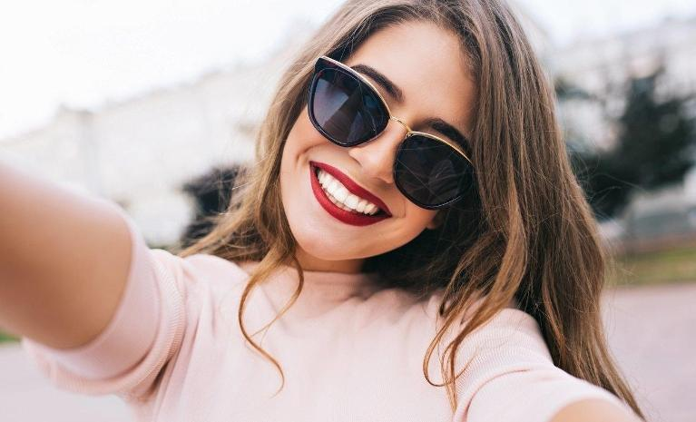 Woman smiling after getting teeth whitened | Dentist Wylie TX